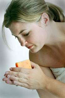 woman washing hands with soap