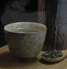 cup of green tea with green tea leaves photo