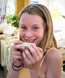 young girl with Herbaria Vanilla soap photo