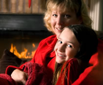 woman and daughter fireside photo