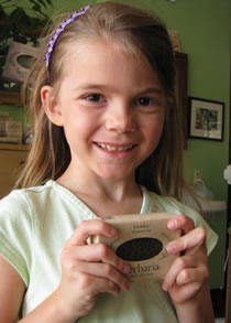Erin McWilliams holding licorice soap bar