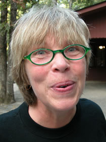 woman with minty green glasses photo