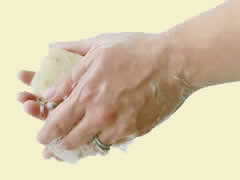 woman washing hands with herbaria all natural soap